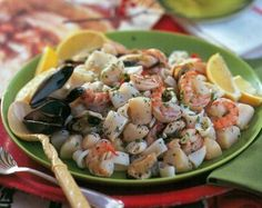 Mary Engelbreit's Traditional Holiday Seafood Salad combines shrimp, scallops and squid, along with fresh peppercorn and lemon juice for a delicious all-in-one salad.