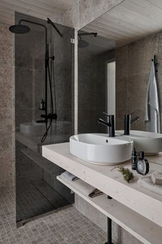 The bathrooms are outfitted with gray, stone-like tiles that reference the outdoors. #dwell #travel #microcabin #moderncabins #finland #prefab Modern Prefab Homes, Modular Homes, Modern Cabins, Cozy Cabin, Cozy Cottage, Timber Boards, Open Showers, Wood Counter, Grey Tiles