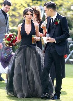 White wedding dresses have been taking the back seat to dresses with a pop of color for awhile now. It's time for black (yes, we said black!) wedding dresses to steal the show! These 15 brides add a non-traditional twist and a lot of edge by rocking black wedding dresses on their big day.