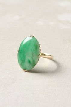 I have a jadeite and gold ring similar to this one.  Pale green with imperial jade deeper green in patches.