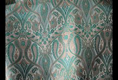 This is a beautiful pure heavy benarse silk brocade floral design fabric in mint and Gold. The fabric illustrate golden woven floral vines on Black background.  You can use this fabric to make...