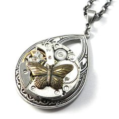 Steampunk watch movement gear necklace featuring a vintage watch movement with exposed gears and real ruby bearings with a whimsical brass butterfly accent. Butterflies and other insects were particul