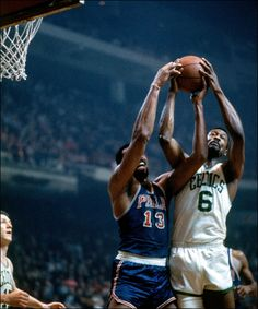 Bill Russell  6 of the Boston Celtics battles for the rebound against . a3338b67a