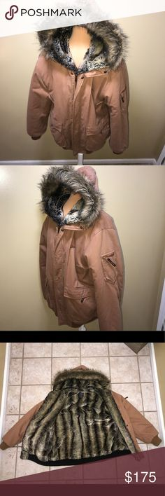 Akademiks Men's coat Akademiks Reversible Men's coat. Camel/tan color. Fully lined multi-color fur, attached hood, lots of pockets (I believe 8!). This coat will blow your mind!  So warm, you will not regret adding this to your wardrobe! Winter is coming!!! Excellent used condition. No stains, no rips...no excessive wear whatsoever. Originally had to wear in Chicago but now live in area that never gets that cold! My loss, your gain! Priced to include extra shipping cost since weighs over…