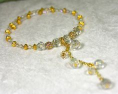 Ten large clear Swarovski crystals of various sizes dominate this memory wire choker fringed with Swarovski pave gold beads and iridescent Czech glass beads. A sexy, romantic gift that won't be forgotten. $25 via Etsy. Get 15% off your entire SmallestPlanet purchase with coupon code PIN15.