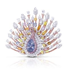 By Graff - 1,305 diamonds, totalling 120.81ct. The star is a 20.02ct pear-shaped Fancy Deep Blue diamond. Fanning out is an array of white, pink, yellow, orange and even green diamonds. The blue diamond centre piece can be detached and worn separately. At 100 million dollars, the most expensive brooch ever?