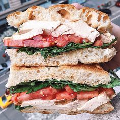 Roast chicken with plum roasted tomato, arugula, and pesto mayo on ciabatta