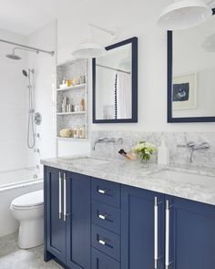 A blue dual washstand donning white and silver pulls is fitted with a polished gray marble countertop holding two sinks beneath polished nickel faucets mounted to a marble backsplash. Hall Bathroom, White Bathroom, Master Bathroom, Bathroom Inspo, Bathroom Inspiration, Bathroom Ideas, Design Inspiration, Blue Vanity, Green Cabinets