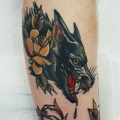 Traditional style wolf and yellow rose tattooed on a calf by @rabtattoo
