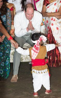 Pin for Later: Kate Middleton and Prince William's Most Precious Moments With Kids  William bowed to a little boy as he performed for the couple during a Bihu Festival Celebration in India in April 2016.
