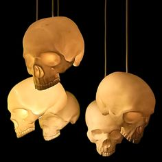 Get some plastic skulls and put a flickering battery votive in each, then hang them by monofilament in a group as Halloween decoration.