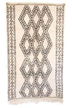 Beautiful vintage Moroccan Beni Ouarain carpet.  All wool.  Such a gorgeous border! Available at Maryam Montague's online Souk!