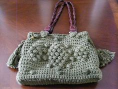 Crocheted purse.  I carry this bag a lot!  Love the green, and the G Darel pattern.  Found the straps on an old purse and they worked great!