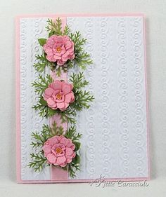 Punched Flower Tutorial from Kitty  3 flowers with greenery place vertically on embossed background