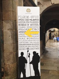 Camino de Santiago Oficina del Peregrino  or Pilgrim's Office (Yes, the sign is missing the apostrophe!) This is the sign to look for in Santiago to receive your compostella.