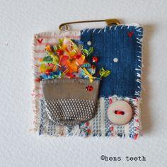 hens teeth : fiber textile Brooch pin :: thimble vase with Ladybird