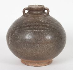 Chinese archaic porcelain vase, Ming Dynasty, 16th century or earlier; incised concentric line decoration and double handles, 6 in. H.
