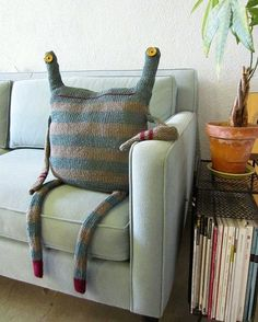 a house guest I need a couch monster. I can totally see j.m Byrd making one of these!I need a couch monster. I can totally see j.m Byrd making one of these! Softies, Couch Monster, Monster Room, Happy Monster, Old Sweater, Sweaters, Upcycled Sweater, Cushions, Diy Crafts