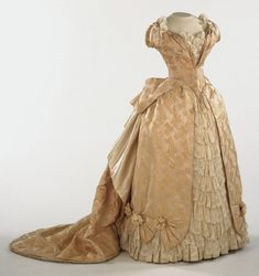 Evening Dress: Bodice And Skirt Made Of Pale Cream Figured Silk And Lace - Possibly Made In France    c.1886-1887   -   The Philadelphia Museum of Art