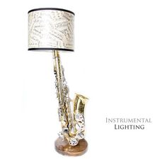 Saxophones, clarinets and other instruments are repurposed into lamps with sheet music lamp shades. I want one made with a tenor sax, please! Saxophone Instrument, Saxophone Sheet Music, Sheet Music Art, Tenor Sax, Painted Pianos, Music Machine, Music Backgrounds, Dark Walnut Stain, Vintage Sheets