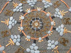 Mandala Art Medium:  ~~grey stone, gold pebbles, bull kelp rope, eucalyptus bark, grey stone, kelp body, bleached seaweed, and black seaweed stipe on dark sand canvas~~