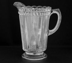 "EAPG McKee ""Adonis"" pattern Water Pitcher 1897, has a pleat and ladder type pattern with a beaded top edge. 8 7/8""H x 5.25""D"