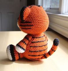 **Please note: This listing is for the pattern (ENGLISH), NOT the actual doll!**  This chubby little tiger cub makes a cute addition to anyone's doll collection! His roly poly body makes him super cuddly and cute! Cubby sits at 7.5 inches tall. He's a shy little guy who likes to observe his surroundings before jumping into any action. He is a loyal friend and a great listener!  When made with the recommended worsted weight yarn and a G hook, this tiger sits at approximately 7.5 inches high…