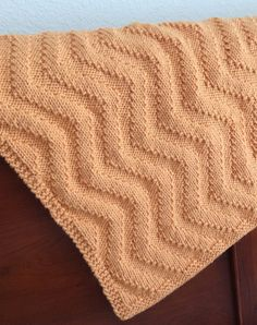 Free Knitting Pattern for Sunshine Chevron Baby Blanket - Chevron pattern worked in just knit and purl stitches. Rated easy by Ravelrers. Quick knit in bulky yarn. Designed by Mari Chiba for Knit Picks. Pictured project by WandaAlice