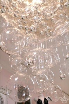 Bubble Chandelier DIY...glass CB2 balls, silver Christmas ornaments,grid panel, etc....