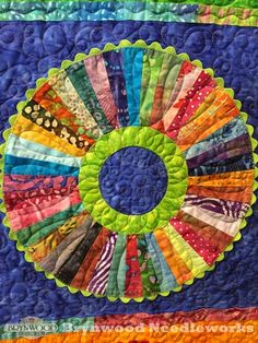 """""""Circus Wheels of Color"""" by Sheila Quinn.  Design: Under The Big Top by Tamara Barfels.  Quilted by Karen Marchetti. Photo by Brynwood Needleworks: 2015 World Quilt Show..."""