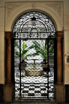 door in cadiz, spain; want to see what's on the other side,... I love the arch and natural light from an indoor courtyard
