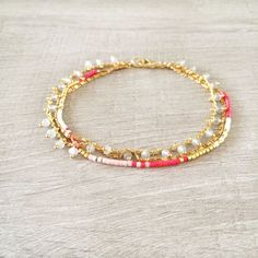 Hey, I found this really awesome Etsy listing at https://www.etsy.com/listing/211279183/multistrand-colorful-bracelet-white-gold