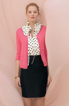 Neutrals+ Color Pop. Looking for a way to spice up your presentation wardrobe without being too flashy? Take a neutral outfit, like this black pencil skirt and polka dotted ruffle top, and pair it with one pop of color.  The pink sweater still looks professional, but makes the outfit a bit more fun.  For a more traditionally authoritative style, swap the sweater for a bold colored blazer, or wear a black blazer with a bright scarf.