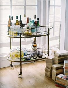 #rethink_hotels Rethink hotels with Tablet. Retro bar cart full of classic cocktail ingredients and vintage glassware is a cool Mad Men style spin on the hotel mini bar.    love it