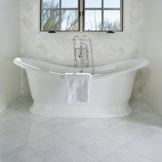 Arizona Tile carries Bianco Carrara in natural stone marble slabs and tiles, a white marble from Carrara, Italy. Carrara Marble Bathroom, Tumbled Marble Tile, Ceramic Tile Bathrooms, Bathtub Tile, Marble Slabs, Marble Tiles, Bathtub Surround, Bathroom Installation, Beautiful Bathrooms