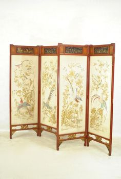 Embroidered silk four panel screens (signed) with asiatic laquered frame c.1890