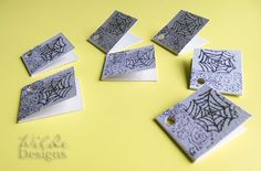 "Spiderweb Gift Tags @ Wilde Designs: Creepy, spooky, and great for Halloween goody bags. Set of seven gift tags with scrollwork accents and heat embossed spider webs in glittery black on heavy gray card stock. They measure 1.75""x1.5."" Each is handmade and unique."