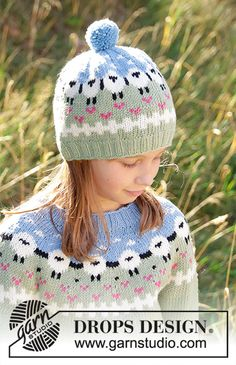 Lamb dance hat / DROPS children - free knitting patterns by DROPS design - Knitted hat for children in DROPS Merino Extra Fine or DROPS Lima. The piece is worked from the bottom up with sheep, color patterns, rib patterns and pompom. Drops Design, Knitted Hats Kids, Kids Hats, Crochet Hats, Knitting Patterns Free, Free Knitting, Baby Knitting, Free Pattern, Crochet Patterns