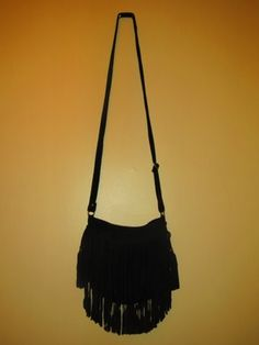 Beautifully hand crafted purse in 100% soft black suede with a double tassel fringe. This purse features a snap clasp for quick and secure closing, a small phone pocket on the inside as well as an adjustable shoulder strap. This is the perfect bag for a day on the town or a fun night out!  heartofthemarket@gmail.com