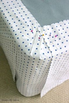 Corner of bedskirt with panels pinned to stay in place