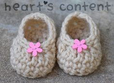 Newborn Crochet Baby Booties Shoes with Pink Flowers. Measures approximately 3 inches in length. A Preemie Baby can grow into these booties.  An adorable Baby Shower Gift. For 30% off use promo code HCPIN201630