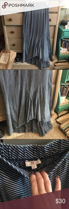 Maxi skirt from anthro! Blue and white striped maxi skirt with ruffle detail at the bottom. Worn but in great condition. It's a small but fits a little bit bigger which is why I am selling! Anthropologie Skirts Maxi