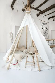 You could wrap the outside of this with fairy lights...amazing cosy reading space.