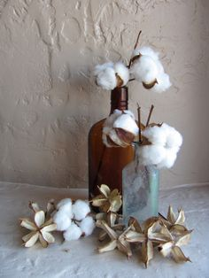 cotton flowers and old glass bottles - centerpiece.  If combined with fire bowls, don't let 'em catch fire, okay?