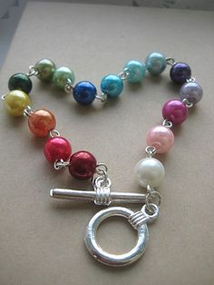 Rainbow glass pearls bracelet by buysomelove on Etsy