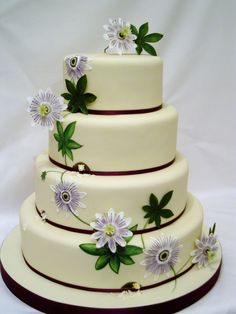 Passion flowers and leaves, some painted onto the cake some made in sugar, with gerbils eating the cake.