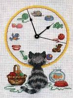 Cat watching clock - free cross stitch pattern
