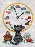 Cat watching clock - free cross stitch pattern