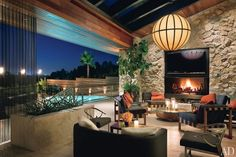 Heated travertine floors warm the lanai of Jennifer Aniston's Beverly Hills home, which was designed by Stephen Shadley.