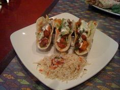 Fish City Grill in Texas, using a square white plate, with the rice set off to the corner. A Chef Series Triple, by The Taco Rack is what is being used here. Providing a great dining experience for the consumer. Awesome platter presentation as always. Increased customer satisfaction, are our goals. Chefs we offer wholesale pricing for the food industry, so stop by www.TacoRack.com, or email Nicolas@TacoRack.com for more information.